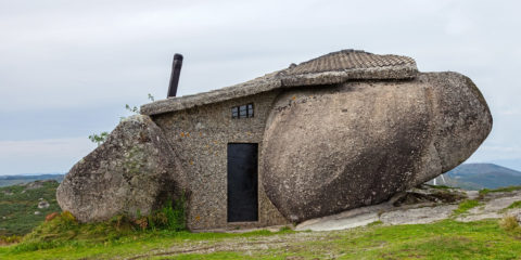 house-built-between-huge-rocks
