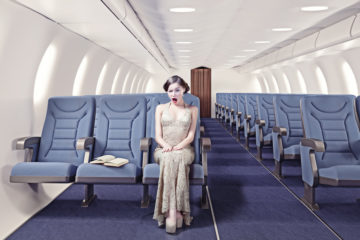 surprised-girl-in-an-airplane