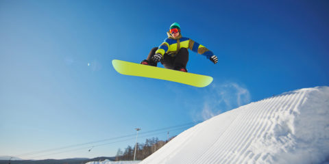 young-man-snowboarding